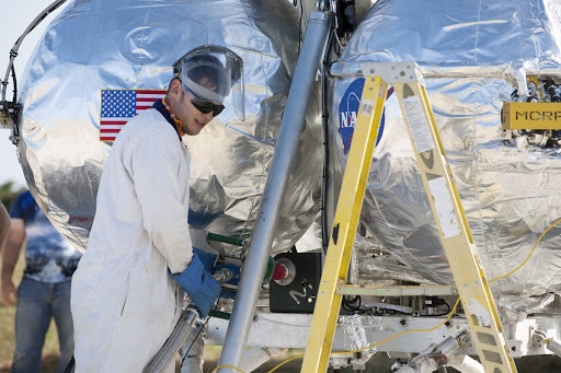 Preparations are underway to prepare the Project Morpheus prototype lander for its first free flight test at the north end of the Shuttle Landing Facility.
