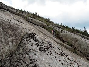Photo: A dominant ledge set a bit over halfway up. It's easier to the right of this.