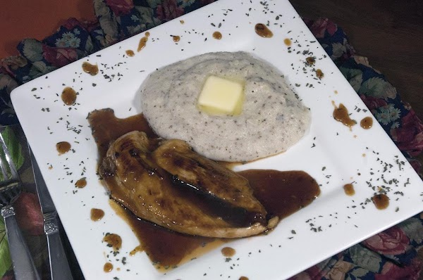 Add a piece of chicken to a plate, drizzle on some of the yummy...