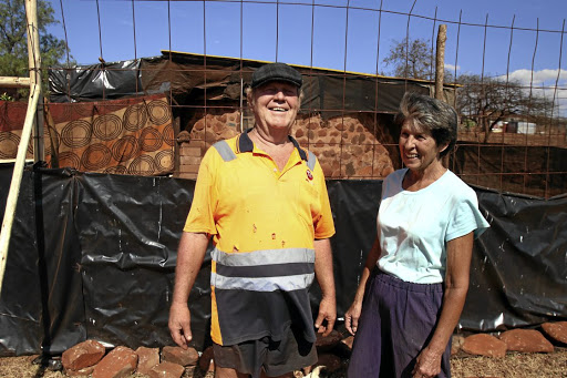 Danie and Kotie Du Toit in front of their unfinished RDP house in Fetakgomo-Tubatse local minicipality in Burgerfort, Limpopo.