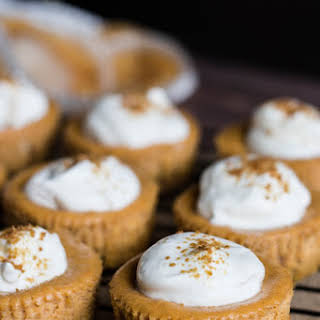 Mini Pumpkin Cheesecakes with Whipped Sour Cream.