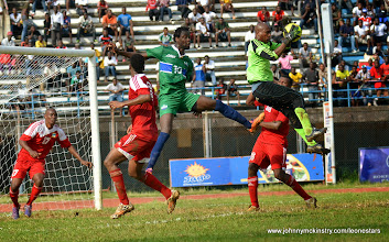 Photo: Kei Kamara jumps for a cross, but the Seychelles keeper intercepts  [Leone Stars v Seychelles, Freetown, 19 July 2014 (Pic: Darren McKinstry)]