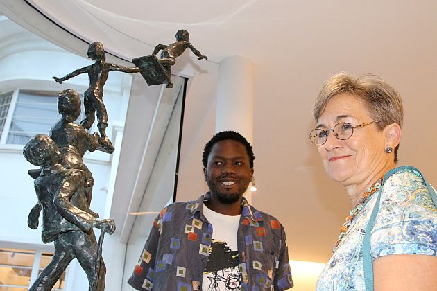 Ludwe Mgolombane and Lynnley Watson view a sculpture on show at GFI Art Gallery at the opening of the Collective Ink exhibition on Wednesday night