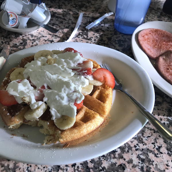 GF Belgian waffle with bananas, strawberries and whipped cream. Side of Pork Roll
