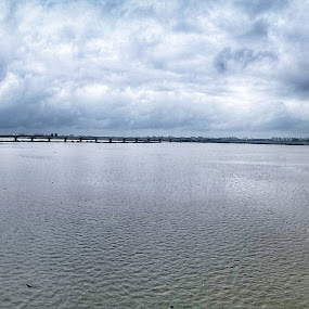 Tapi by Himanshu Jethva - Landscapes Waterscapes ( clouds, water, raavangraphy, sky, blue, surat, weather, india, moonsoon, ibdia, tapi )