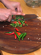 Photo: cutting Thai chillies for the hot sauce