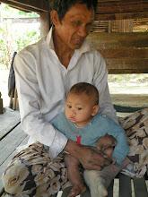 Photo: Landmine Survivor Neal Harv with son