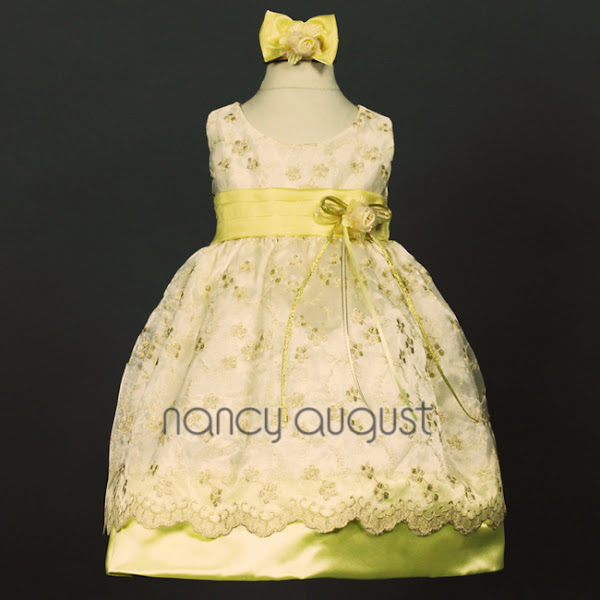 Photo: Exclusive Soft Yellow Baby Dress with Shimmering Gold Embroidered Skirt: This fabulously gold baby dress will be remembered at any Christmas party or special holiday event. The regal color of this baby dress is pleasant to be around and will make everyone ohhh and ahhh. This dress offers a sleeveless design, a detachable floral bouquet on the satin waistline and headband, a crinoline enhanced, sensational embroidered overskirt and a exposed thick satin hemline. For the finishing touches, it comes with a matching satin headband and pink bloomers. We are positive this sweet baby dress will bring a big smile to your baby girls face.