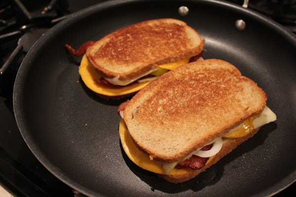 Spread butter on the outsides of the bread and place in medium hot skillet....