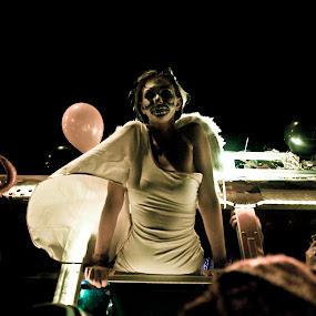 Angel or Demon by Surentharan Murthi - News & Events World Events ( angel, girl, photojournalism, festival, new york, demon, city )