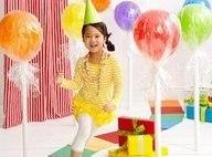 Helium Balloons wrapped in cellophane. this would be adorable for a lolly pop party!!!