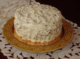 Make frosting and frost the cooled cake, put 1/2 cup finely chopped nuts on...