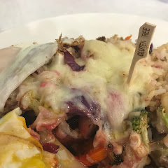 Hippie hash - broccoli, cauliflower, beets, cheese, potatoes, brown rice, cabbage and eggs of your choice (basted med). Filling after the first bite!