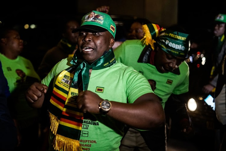 Supporters of Zanu-PF celebrate the results of Zimbabwe's election, in Harare in the early hours of August 3 2018, after the Zimbabwe Electoral Commission declared Emmerson Mnangagwa the winner of the presidential poll. Picture: AFP