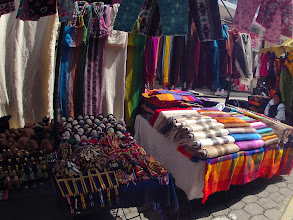 Photo: Just one of the many colorful alpaca markets in Ecuador. This one is in Otavalo, a city very proud of its ethnic culture and fiber traditions.