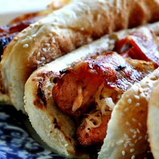 Grilled Bacon-Wrapped Stuffed Hot Dogs.
