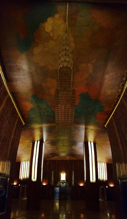 The 1st floor lobby with the Chrysler Building painted on the ceiling.