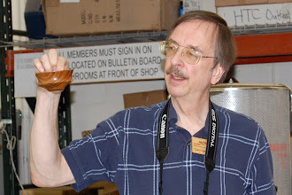 Photo: Gary Guenther shows off the serendipitous design of his latest bowl and ...
