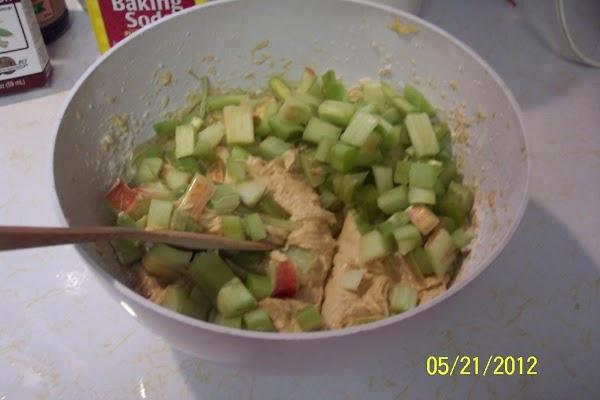 Add cut up rhubarb, mix. Put into the prepared pan.