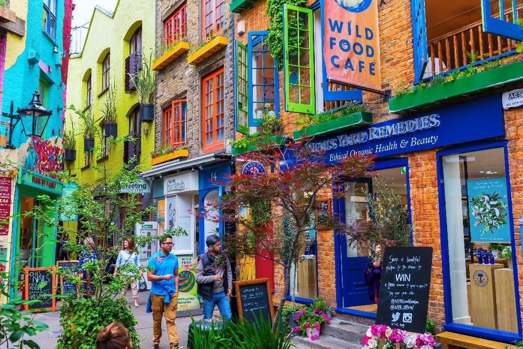 People shopping in Neal's Yard, Covent Garden