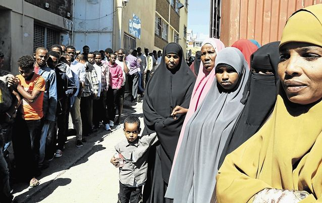 Foreign nationals queue at a Home Affairs office for permits and applications. Picture: EUGENE COETZEE