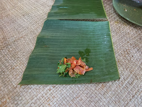 Photo: Wrapping fish in banana leaves