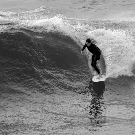 Fistral Ride by DJ Cockburn - Sports & Fitness Surfing ( fistral bay, surf, surfer, england, britain, cornwall, wetsuit, surfing, recreation, fistral beach, sea, wave, grayscale, ocean, uk, monochrome, atlantic ocean, man, black and white, watersport, sport )
