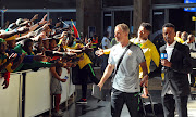 Bafana Bafana coach Stuart Baxter greets fans at OR Tambo International Airport after the team arrived back from Africa Cup of Nations duty in Egypt.