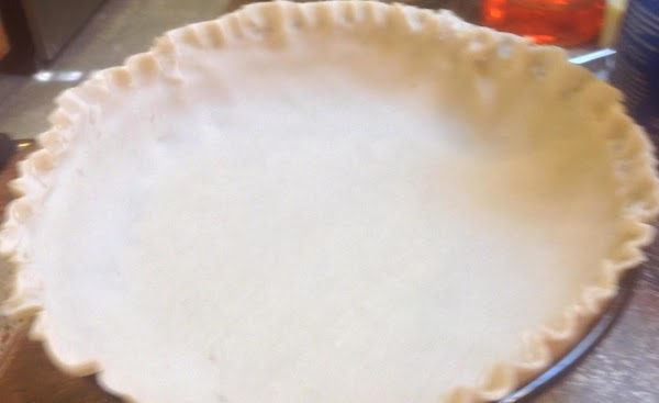 Unroll pie crust and position into a 9 inch glass pie plate. Press down...