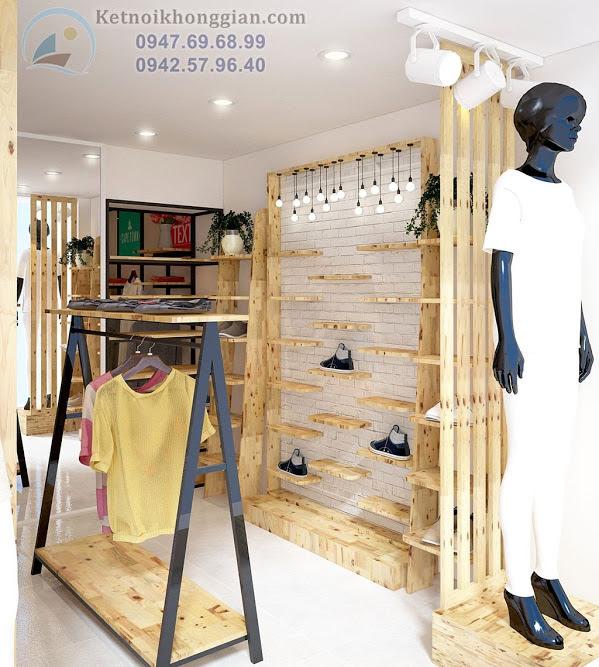 thiết kế cửa hàng thời trang trắng vàng vân gỗ