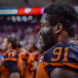 Standing For National Anthem by Garry Dosa - Sports & Fitness American and Canadian football ( orange, sports, teams, players, black, bokeh, indoors, cfl, stadium, football, lighting, people )