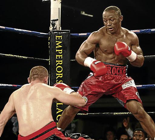 Thabiso Mchunu floors Daniel Venter during an  ABU cruiserweight title fight at Emperors Palace  .  / Antonio Muchave