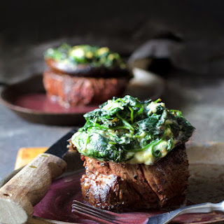 Beef Tenderloin Fillets with Spinach Cambozola Stuffed Portobello Mushrooms and Red Wine Sauce.