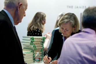 """Photo: Karen Elliott House signs copies of her book, """"On Saudi Arabia: Its People, Past, Religion, Fault Lines - and Future,"""" at the RAND Politics Aside event in Santa Monica, Calif. The event was Nov. 15-17, 2012 at the RAND headquarters campus."""