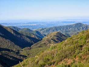 Photo: View south toward San Dimas Canyon and the Pomona Valley beyond. Johnstone Peak (3178') stands on the right.