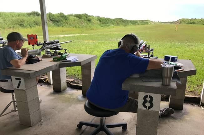 two men benchrest shooting