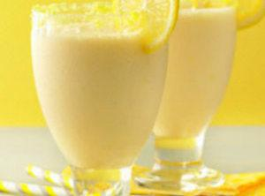 In a shallow dish, mix crushed lemon drops and sugar. Using 1 or 2...