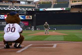 Photo: Maj. John Donovan shakes off the sign from T.C. Bear as he prepares to throw the first pitch at Target Field on Sept. 1, 2015. Donovan celebrated in the pregame pageantry on behalf of Minnesota Recovery Connection to kick off National Recovery Month, which aims to raise awareness of the support services available to help people overcome drug and alcohol addiction. Minnesota National Guard photo by Army Staff Sgt. Patrick Loch/ Released