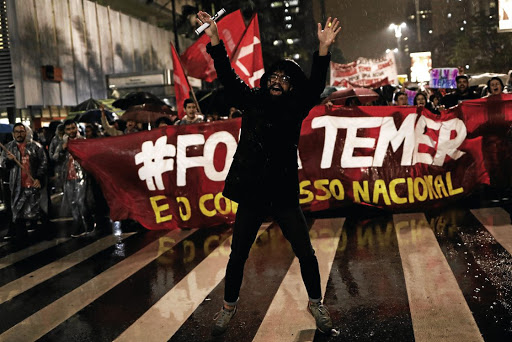 Demonstrators take part in a protest against Brazil's President Michel Temer in Sao Paulo, Brazil, on May 18 2017. The banner reads: