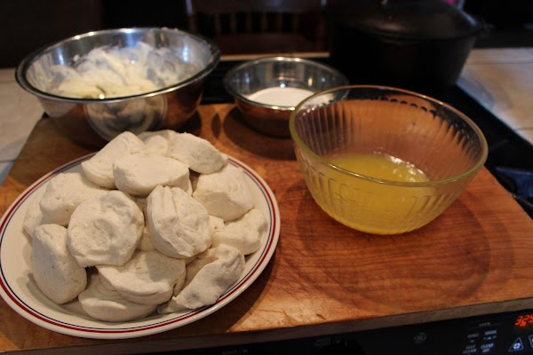 Set up your workstation. A cutting board to prepare the biscuit. The bowl with...