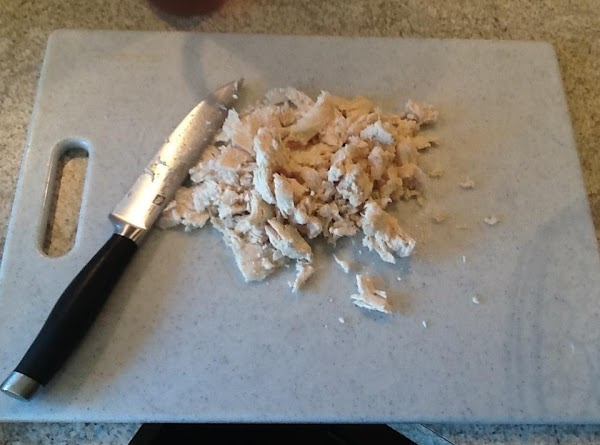 Boil chicken for about 30 minutes. Once done, chop or shred. You can also...