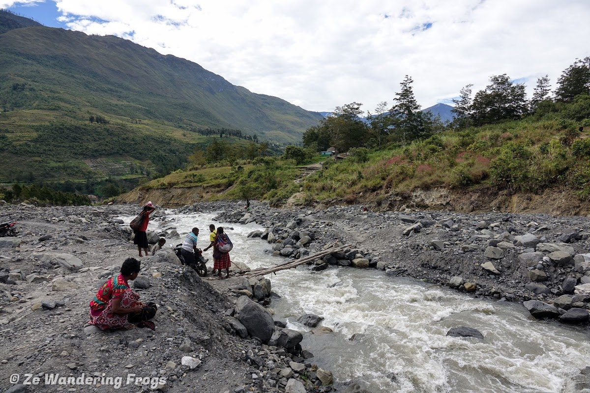Indonesia. Papua Baliem Valley Trekking Planning. Small bridge and river crossing after a landslide