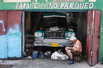 Photo: Hard at Work  Things tend to happen at a pretty slow pace in Cuba. Presumably this guy was supposed to be fixing the car but the book was proving to be far more interesting. We watched him for a while and took a few photos but he didn't look up once the whole time.  #PeopleAtWorkMonday curated by +Baki Karacay
