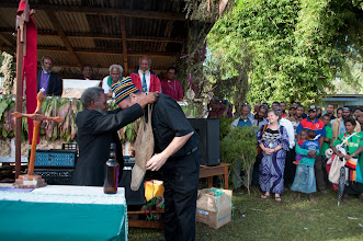 Photo: Rev John Mehl receiving the Bible translated for the Enga people.