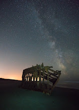 Photo: I've got much to learn about night photography.  Last weekend I went out to the Peter Iredale to play under the stars. Most of the time I was there people had fires, flashlights, and kids running everywhere so I just played around with different settings to see what I could get. Most of those shots included light trails, odd glows, and a lot of light pollution in the background. In the end my biggest challenge was focusing the camera, even with my bright led light it was a major challenge. This shot was taken after a police officer came and cleared out the people parked in the lot that closes at 10PM. He was super kind and let me and another photographer stay for another hour. He did mention that parking on the beach does not close... noted for the future.  #sonyalpha  #exploregon  #nightphotography
