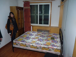 Photo: Beijing - 2nd room already much nicer than previous in warm apartment on 2nd floor out of 6, no internet (possible shared), small superbasic kitchen, crappy bathroom, only 3 bedrooms (couple and man), 1 available, nearby bus stop with noise from buses on the street but bearable, bed, couch and wardrobe for 1500RMB + utilities per month, immediately crisscrossed previous room on paper, checking rooms with my colleague Stella