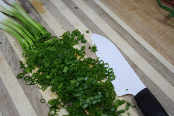 Prior to serving, add 1 bundle of finely sliced green onion tops and dried...