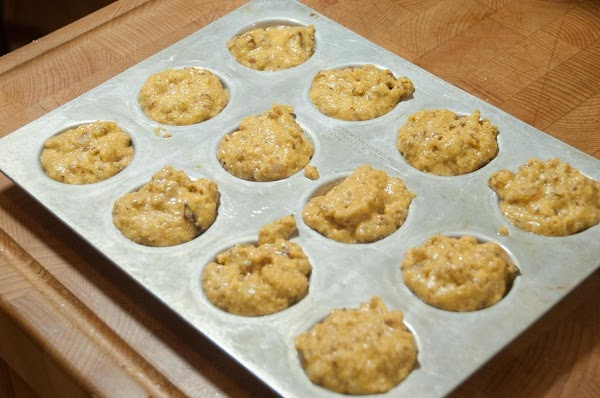 Add a tablespoon of batter to the cups of a mini muffin tin.