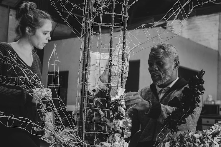 Artist Sithembiso Shangase talking about his art with curator Christine Adams. Picture: SUPPLIED