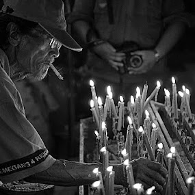 A candle flame guard by Rudyanto A. Wibisono - News & Events World Events (  )